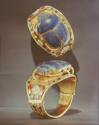 One of Tutankhamun's many bracelets found in his tomb, shown two ways.  The setting is gold, topped by a scarab beetle made of lapis lazuli and accented with various stones like carnelian, turquoise, and amazonite (feldspar).